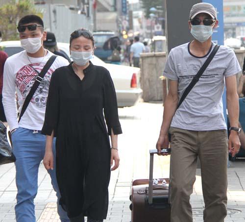 Coreanos durante el brote de MERS. Imagen: Xinhua net